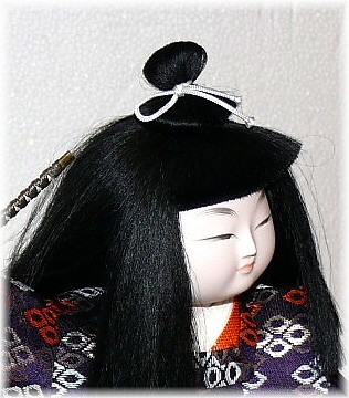 japanese traditional doll of a young samurai with sword