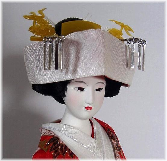 Japanese bride doll dressed in wedding costume. Japanese ...