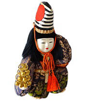 japanese vintage kimekomi doll of a boy with bell